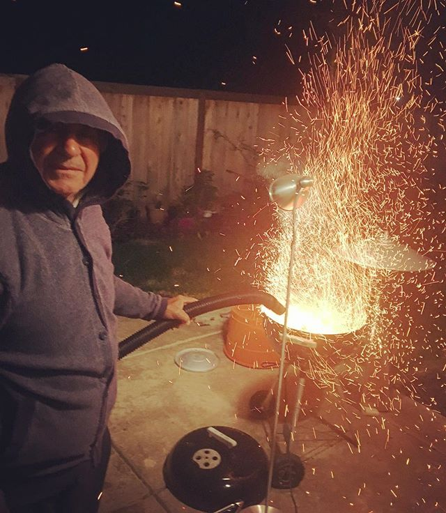This is my dad getting the BBQ ready with the help of his ShopVac. Usually he uses a ionizing hair dryer but I guess he thought of a faster solutions. 🌬 You can follow him @cupofjamshid #dadsolutions #dadsofinstagram #genius #inventor #innovator #jimmyrigged #dangerous #sharktank #cupofjamshid #jamshidstyle #shopvac #pyro #fire #bbq #persian #kabobs #koobideh